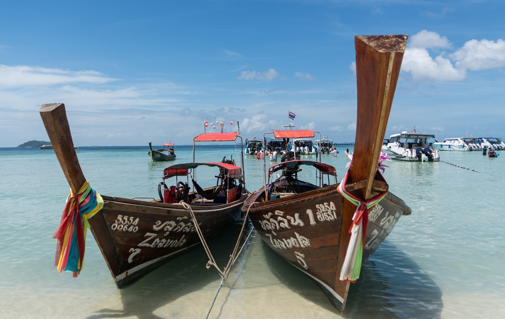 thai longtail boats beach koh phi phi island thailand