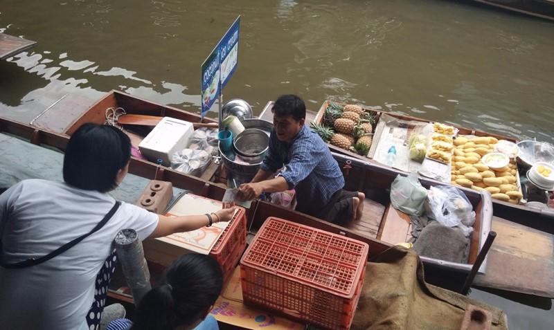 Damnoen Saduak Floating Market coconut ice cream vendor