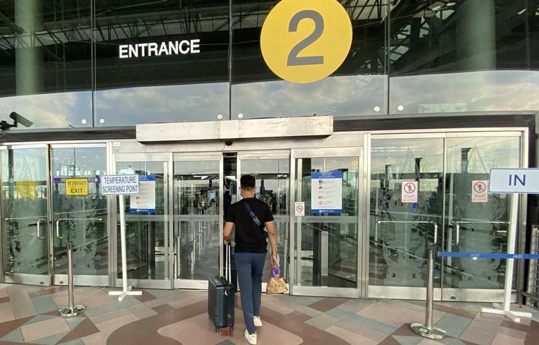 checking in for a flight at bangkok airport coronavirus temperature check
