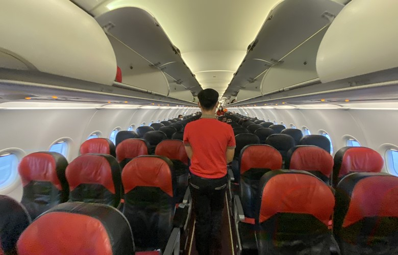 empty airplane carrying travellers during the coronavirus the new normal