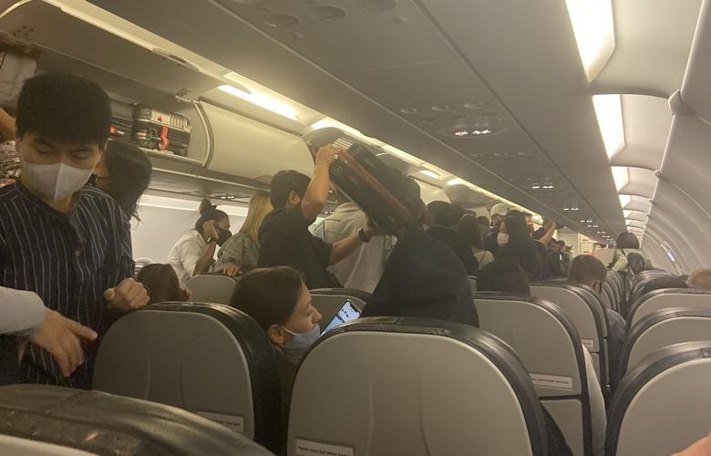 passengers on airplane during coronavirus flught pandemic