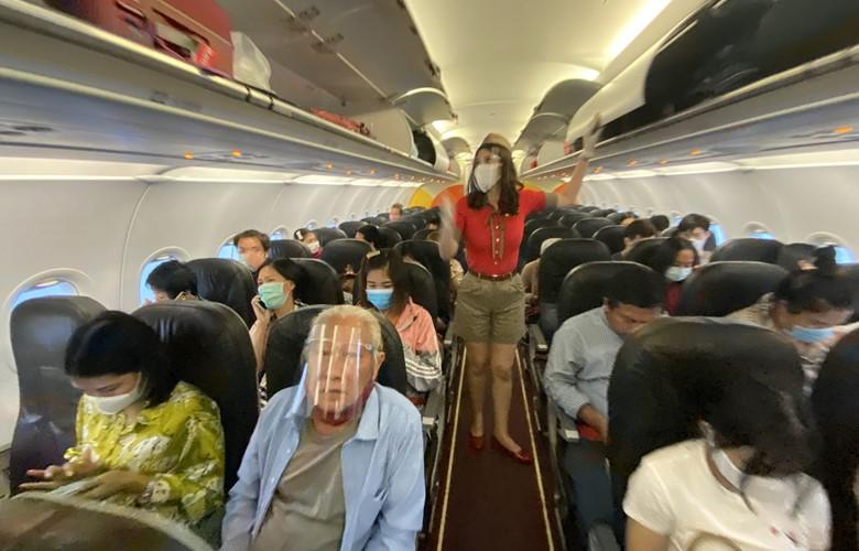 passengers wearing facemasks on a flight during the coronavirus pandemic